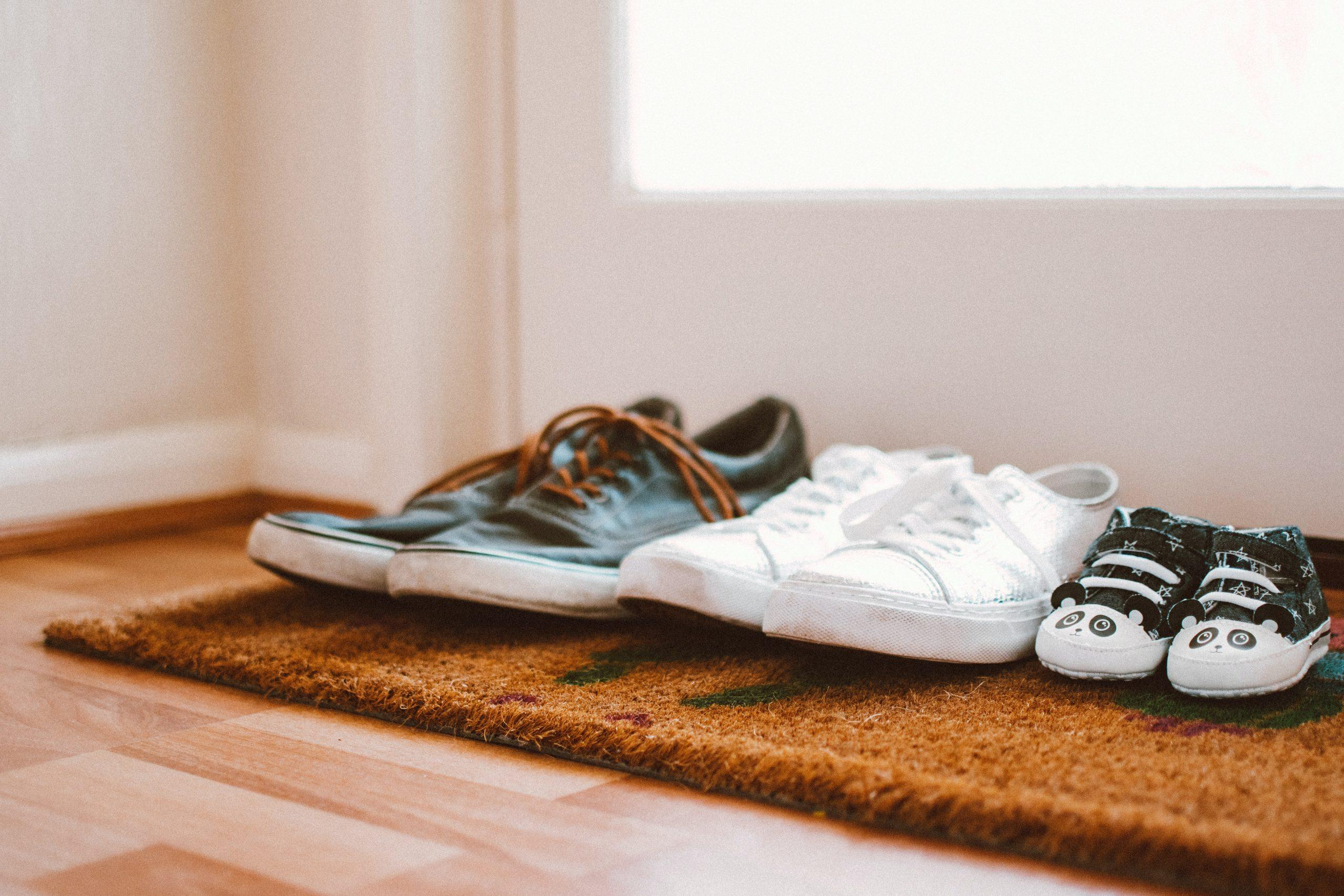 family represented in three pairs of shoes, going from adult to child